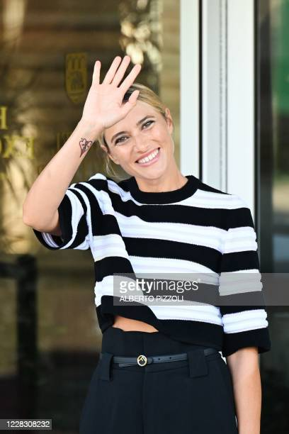 Master of Ceremonies and sponsor of the 77th Venice Film Festival Italian actress Anna Foglietta waves outside the Excelsior Hotel on the opening day...