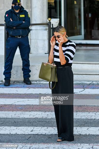Master of Ceremonies and sponsor of the 77th Venice Film Festival Italian actress Anna Foglietta puts on her sunglasses outside the Excelsior Hotel...