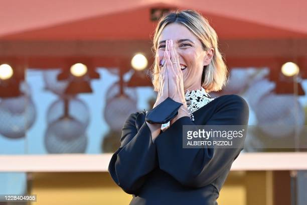 Master of Ceremonies and sponsor of the festival Italian actress Anna Foglietta laughs as she arrives for the screening of the film Notturno...