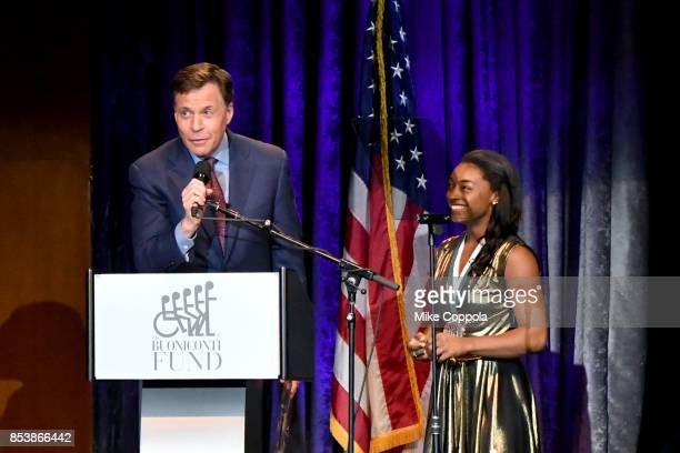 Master of Ceremonies Bob Costas and GSLD Honoree Simone Biles speak onstage at the 32nd Annual Great Sports Legends Dinner To Benefit The Miami...