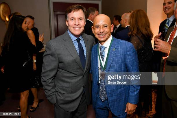Master of Ceremonies Bob Costas and Mike Smith attend the 33rd Annual Great Sports Legends Dinner, which raised millions of dollars for the...