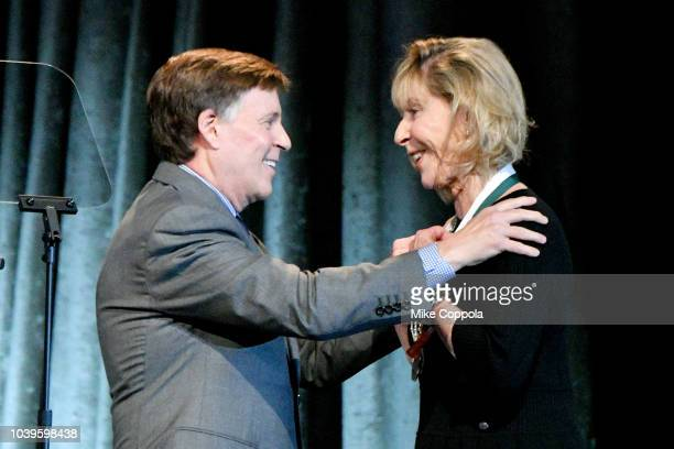 Master of Ceremonies Bob Costas and Terry Buoniconti speak onstage during the 33rd Annual Great Sports Legends Dinner which raised millions of...