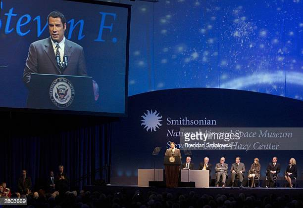 Master of Ceremonies John Travolta addresses guests at the dedication ceremony of the Steven F UdvarHazy Center the SmithsonianÕs new addition to the...