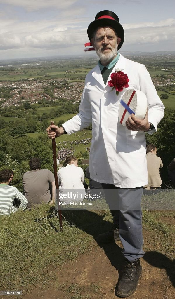 Master of Ceremonies Rob Seex holds a Double Gloucester cheese on Coopers Hill before the start of Cheese Rolling races, on May 29, 2006 in Gloucester, England. The annual tradition which is thought to date back to Roman times, draws competitors from far afield to race the cheese 200 yards down a near vertical slope in pursuit of a seven-pound Double Gloucester cheese. Injuries are commonplace, even forcing the cancelation of the event in the past.
