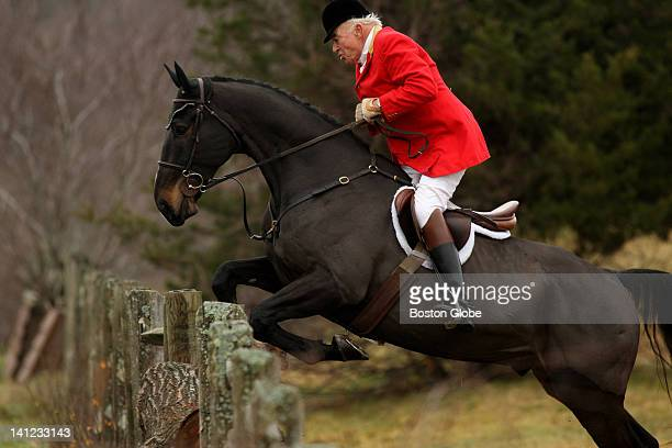 Master of the Foxhounds Donald V Little of Hamilton jumped over an obstacle at Groton House Farm in Hamilton on Nov 26 Myopia Hunt Club closed out...