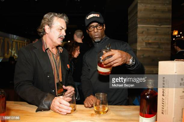 Master of Whiskey Ed Adams introduces 'They Die By Dawn' actor Isaiah Washington to the new Bulleit 10 at the Bulleit Bourbon preview party during...