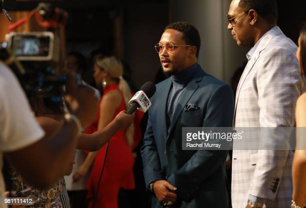 Master P and Romeo Miller arrive at the BET Her Awards Presented By Bumble at Conga Room on June 21 2018 in Los Angeles California