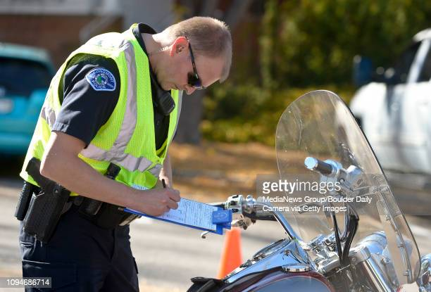 Master police officer Paul Beach investigates a collision involving a motorcycle on Coffman Street near Third Avenue Wednesday