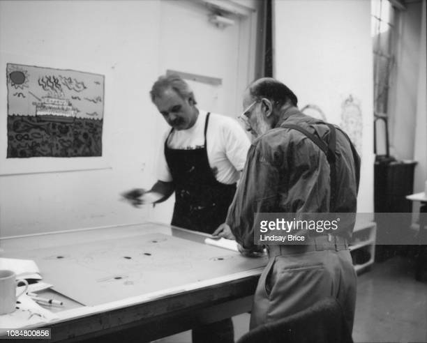 Master Printer James Reid works with Allen Ginsberg at the drafting table in studio at Gemini GEL as Ginsberg prepares his Buddhist drawings for a...