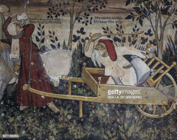 Master rebuking his servant who has stopped to drink detail from the Fountain of Youth fresco in the Baronial Hall Castle of Manta Saluzzo Piedmont...