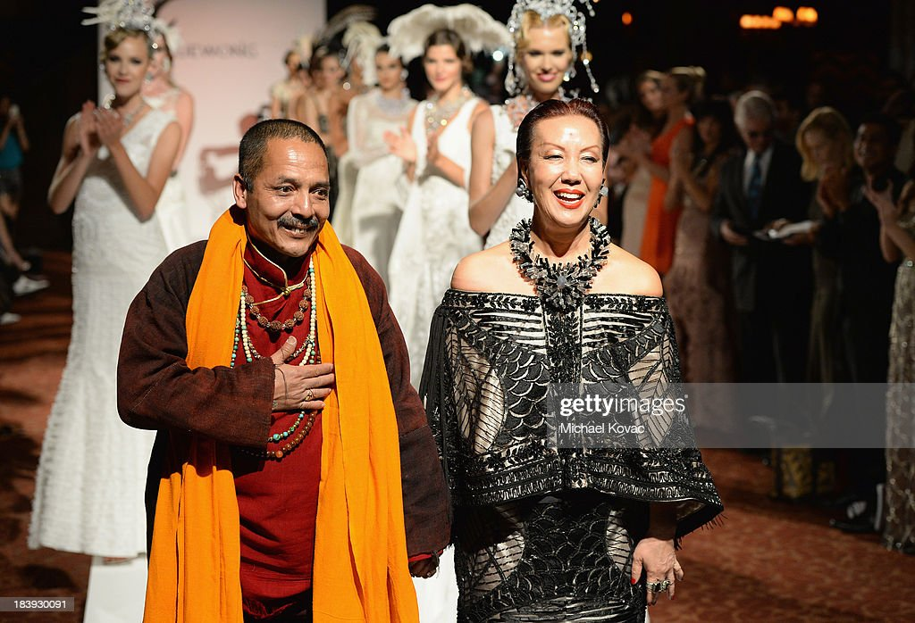 Master Romio (L) and designer Sue Wong attend Sue Wong 'Jazz Babies' Spring 2014 Runway Show on October 9, 2013 in Los Angeles, California.
