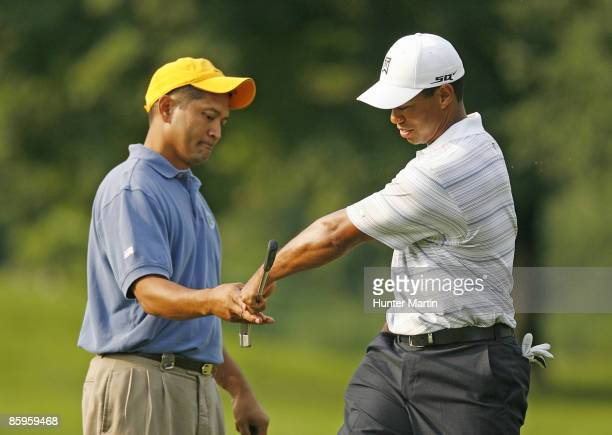 JULY 4 Master Sergeant Andy Amor gets congratulations from Tiger Woods during the ATT National Earl Woods Memorial ProAm at Congressional Country...