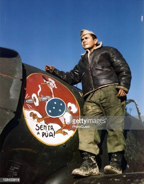 Master Sergeant Robson Saldanha poses beside the bird insignia of the First Brazilian Fighter Squadron painted on a P47 Thunderbolt Italy 1944 The...