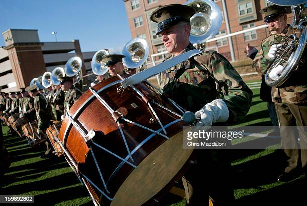 """Master Sgt David Murray prepares his bass drum as The President's Own"""" United States Marine Band rehearse for the 2013 inaugural swearingin ceremony..."""