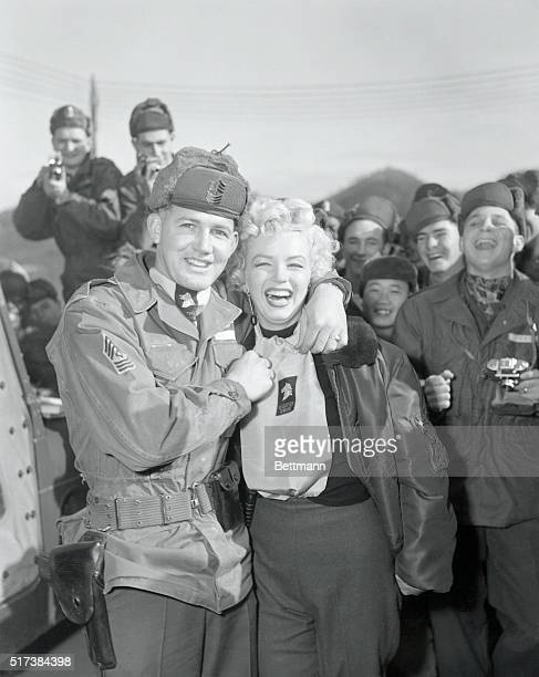 Master Sgt Guy Morgan of Marion North Carolina presenting a 25th Division 'Wolfhounds' scarf to Marilyn Monroe