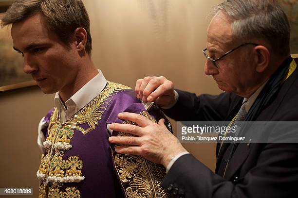 Master tailor Antonio Lopez Fuentes makes a mark with chalk on French bullfighter Juan Bautista Jalabert's new outfit for final retouches at 'Fermin'...