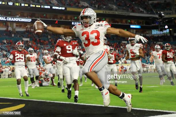 Master Teague III of the Ohio State Buckeyes rushes for an eight yard touchdown during the first quarter of the College Football Playoff National...