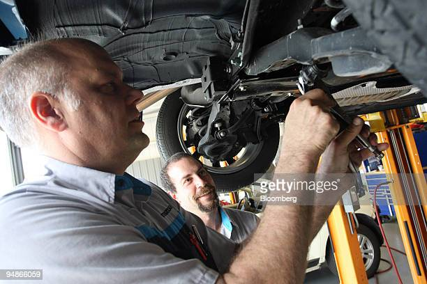 Master technician Peter Mack left and technician Ross Brault work on a stabilizer link on a Mazda 3 at the Ed Morse Mazda dealership in Port Richey...