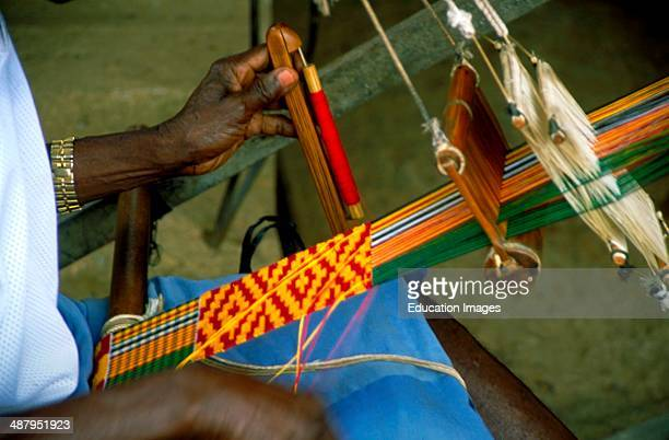 A master weaver at work making kente cloth in the village of Bonwire near Kumasi the capitol of the Ashanti Region in Ghana West Africa