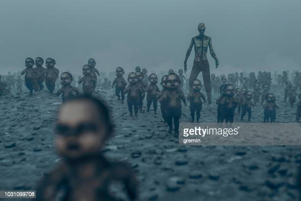 master zombie with walking dead zombie children - halloween kids stock photos and pictures