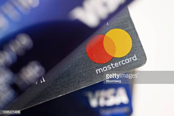 Visa Inc and Mastercard Inc credit cards are arranged for a photograph in Tiskilwa Illinois US on Tuesday Sept 18 2018 Visa and Mastercard agreed to...
