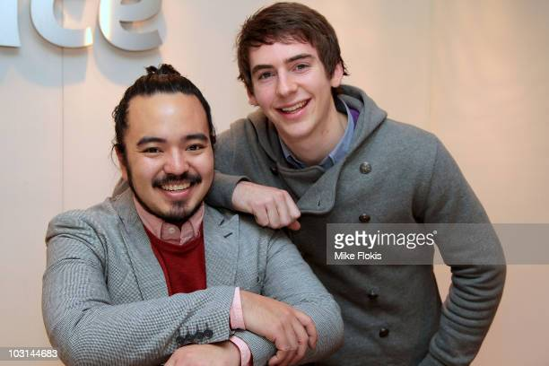 Masterchef series 2 winner Adam Liaw and runnerup Callum Hann pose for a photo at the George Street Telstra store on July 29 2010 in Sydney Australia...
