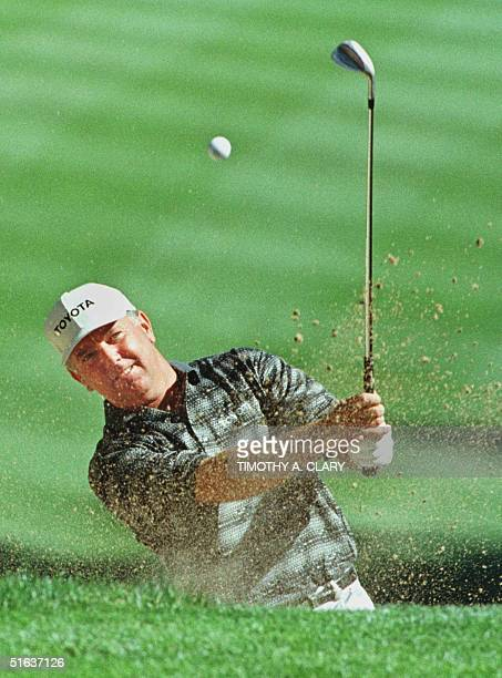 Masters and British Open Champion Mark O'Meara of the US blasts out of the trap on the 15th hole 12 August during the final practice round for the...