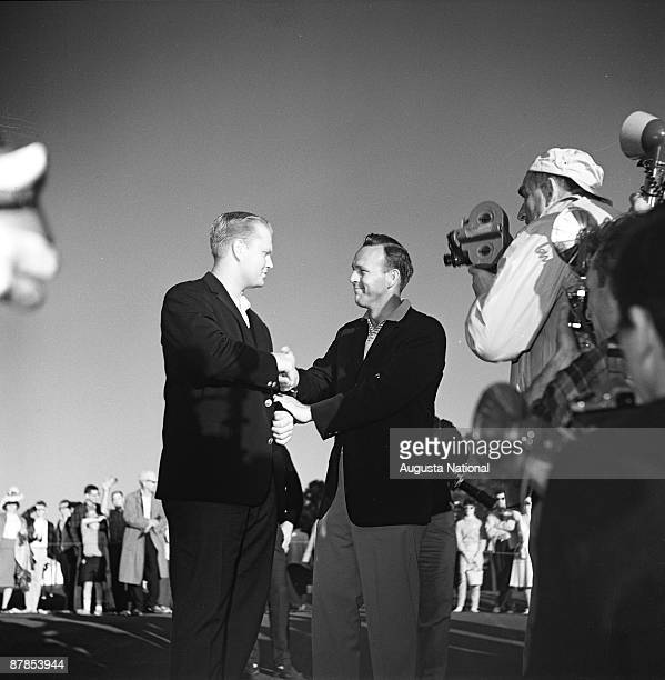 Masters Champion Arnold Palmer congratulates 1963 Masters Champion Jack Nicklaus during the 1963 Masters Tournament at Augusta National Golf Club 0n...