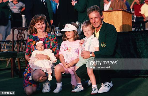 Masters Champion Bernhard Langer kneels down with his wife Vikki Carol and his three children Jacki Stephan and Christina at the Presentation...
