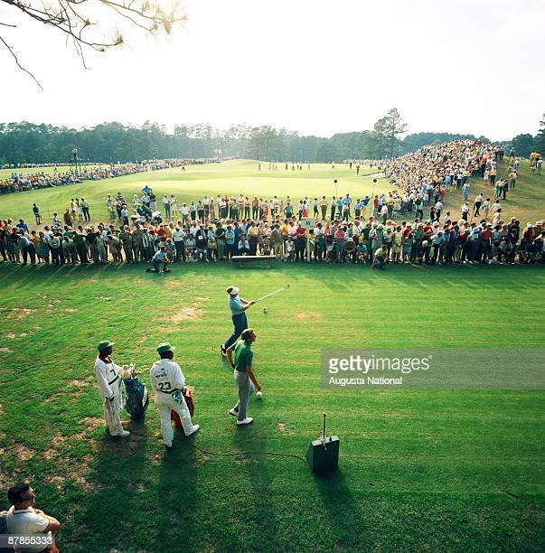 Masters Champion Bob Goalby hits from the 18th tee box in front of a large gallery during the 1968 Masters Tournament at Augusta National Golf Club...
