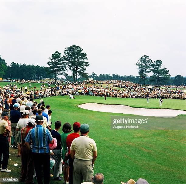 Masters Champion Bob Goalby putts in front of a large gallery during the 1968 Masters Tournament at Augusta National Golf Club in April 1968 in...