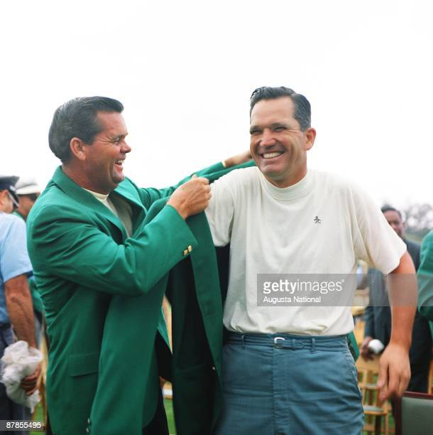 Masters Champion Bob Goalby receives his Green Jacket from 1967 Masters Champion Gay Brewer at the Presentation Ceremony during the 1968 Masters...