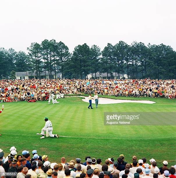 Masters Champion Bob Goalby shakes hands on the 18th green in front of a large gallery during the 1968 Masters Tournament at Augusta National Golf...