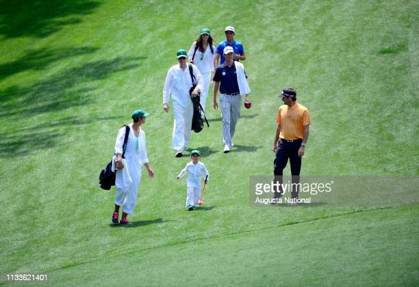 Masters champion Bubba Watson and his wife Angie and son Caleb walk down the No. 1 fairway with the Webb Simpson and Rickie Fowler group during the...