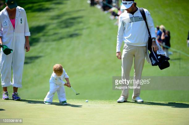 Masters champion Bubba Watson and his wife Angie watch their son Caleb putt on No. 1 green during the Par 3 Contest at Augusta National Golf Club on...