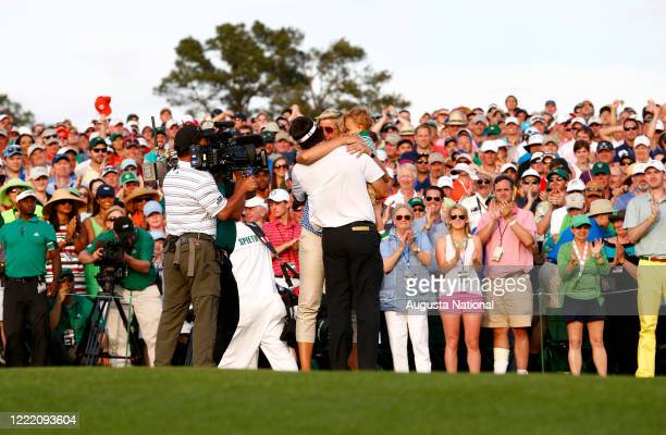 Masters champion Bubba Watson hugs his wife Angie and son Caleb after he won the 2014 Masters during the final round at Augusta National Golf Club on...