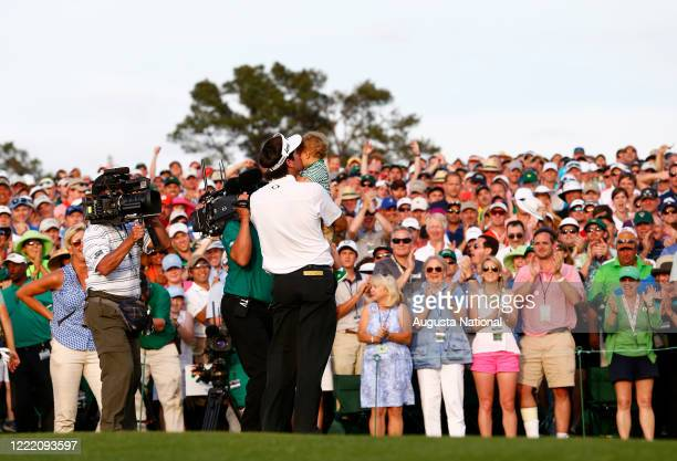 Masters champion Bubba Watson kisses his son Caleb on No. 18 green as he celebrates winning the 2014 Masters during the final round at Augusta...