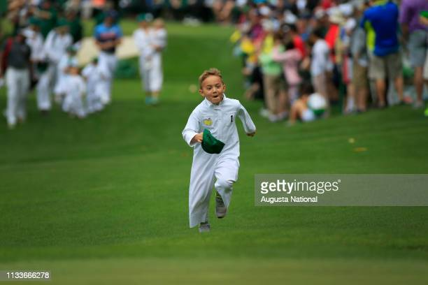 Masters champion Bubba Watson's son Caleb runs ahead during the Par 3 Contest at Augusta National Golf Club, Wednesday, April 4, 2018.
