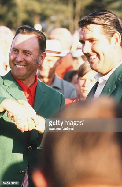 Masters Champion Charles Coody shakes hands with Billy Casper at the Presentation Ceremony during the 1971 Masters Tournament at Augusta National...