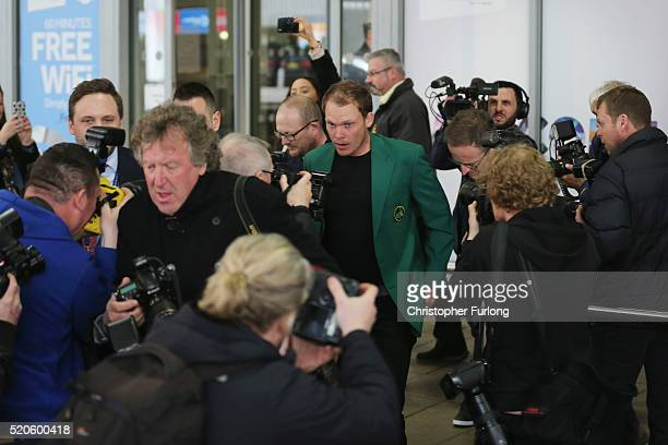 Masters champion Danny Willett arrives back in the UK wearing the famous green jacket at Manchester Airport on April 12 2016 in Manchester England...