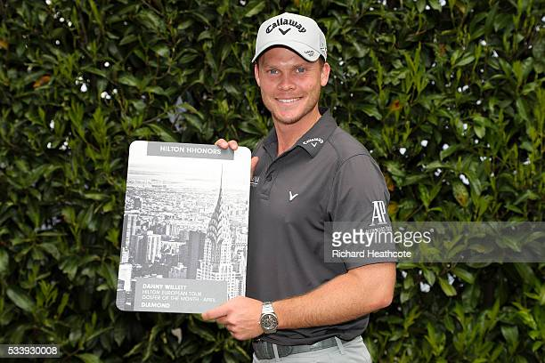 Masters champion Danny Willett of England is presented with the Hilton European Tour Golfer of the Month award for April during a practise round for...