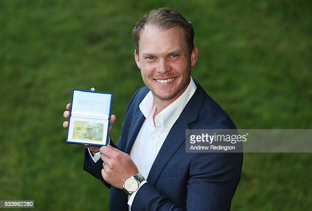 Masters Champion Danny Willett of England poses after receiving European Tour Honorary Life Membership during the BMW PGA Championship Reception...