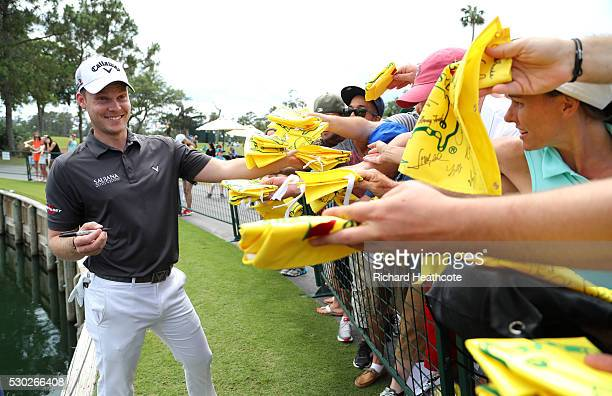 Masters Champion Danny Willett of England signs autographs during a practise round for THE PLAYERS Championship on The Stadium Course at TPC Sawgrass...