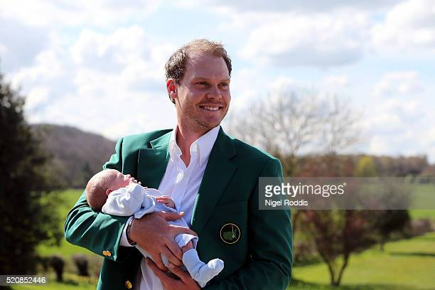 Masters champion Danny Willett poses for photographs wearing the famous green jacket with son Zachariah at Lindrick Golf Club on April 13 2016 in...