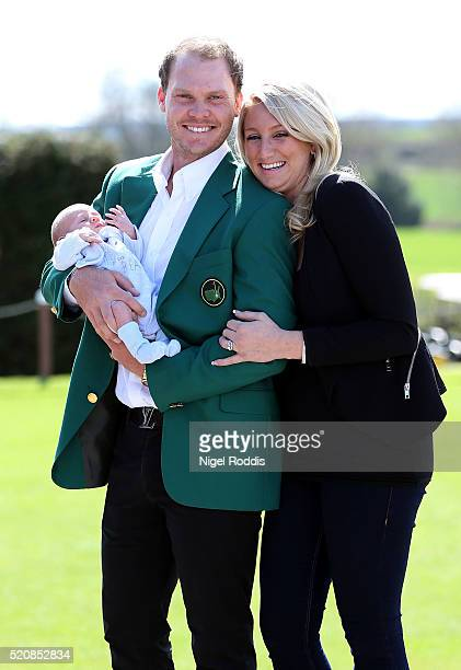 Masters champion Danny Willett poses for photographs wearing the famous green jacket with wife Nicole and son Zachariah at Lindrick Golf Club on...