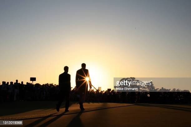 Masters champion Dustin Johnson of the United States walks to the Green Jacket Ceremony after Hideki Matsuyama of Japan won the Masters at Augusta...