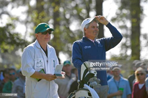 Masters champion Fred Couples and his caddie Mark Chaney look down the fairway from the tee box on Hole No 4 during the second round of the Masters...