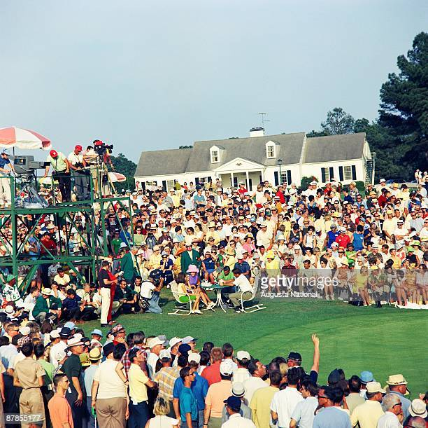 Masters Champion Gay Brewer and Runnerup Bobby Nichols sign scorecards on the edge of the 18th green in front of a large gallery during the 1967...
