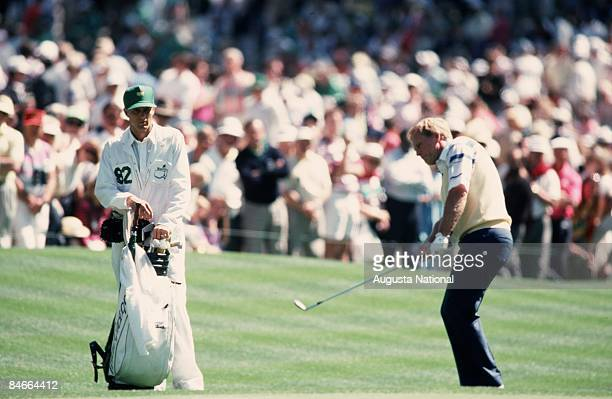 Masters Champion Jack Nicklaus chips in front of his son and caddie Jackie Nicklaus during the 1990 Masters Tournament at Augusta National Golf Club...