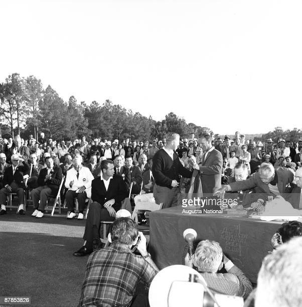 Masters Champion Jack Nicklaus recieves his Green Jacket from 1962 Masters Champion Arnold Palmer at the Presentation Ceremony during the 1963...